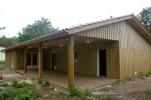 Maison en bois de 156m2 avec terrasse entièrement couverte