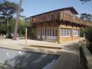 Extension bois d'une maison au Cap Ferret avec étanchéité par toit terrasse