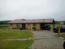 Maison en bois de plain pied dans le Lot et Garonne. Bardage en volige pin couvre-joint.